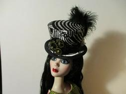 Black Carnival a Doll Top Hat for The Steam punk look.
